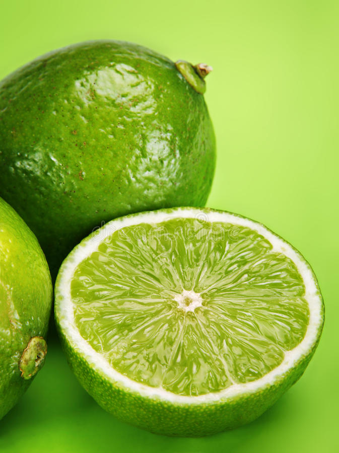 Citrus lime. Citrus fruit green lime with slice closeup royalty free stock photos