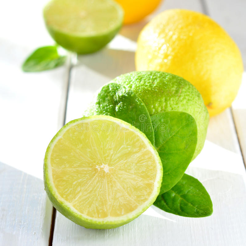Citrus lime and lemon on a white table royalty free stock image