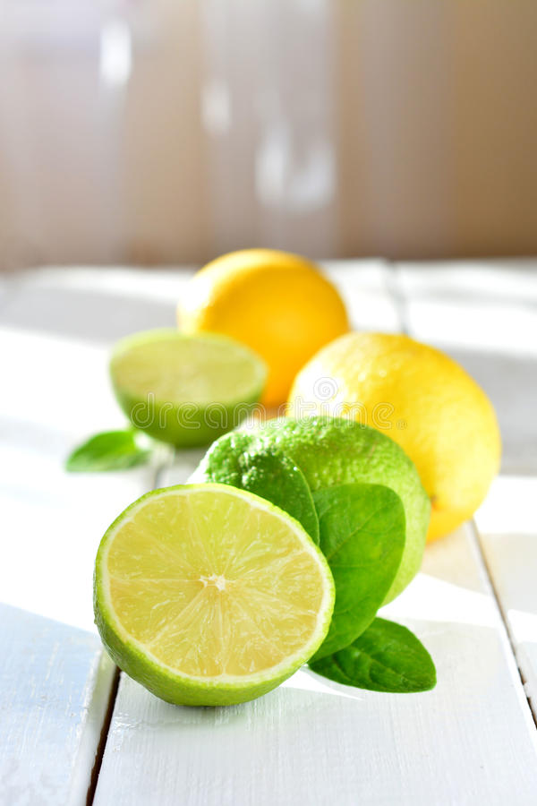 Citrus lime and lemon on a white table royalty free stock photography