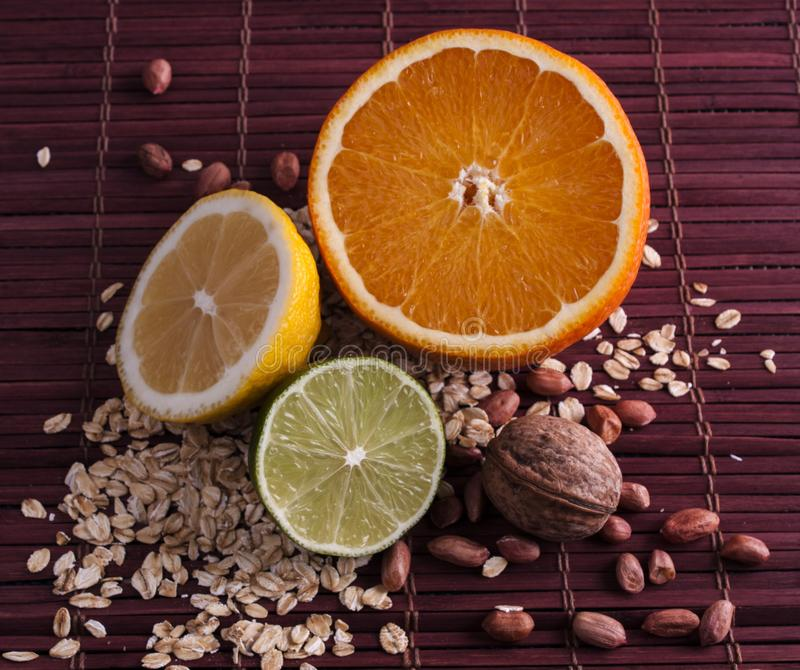 Citrus and nuts royalty free stock photography