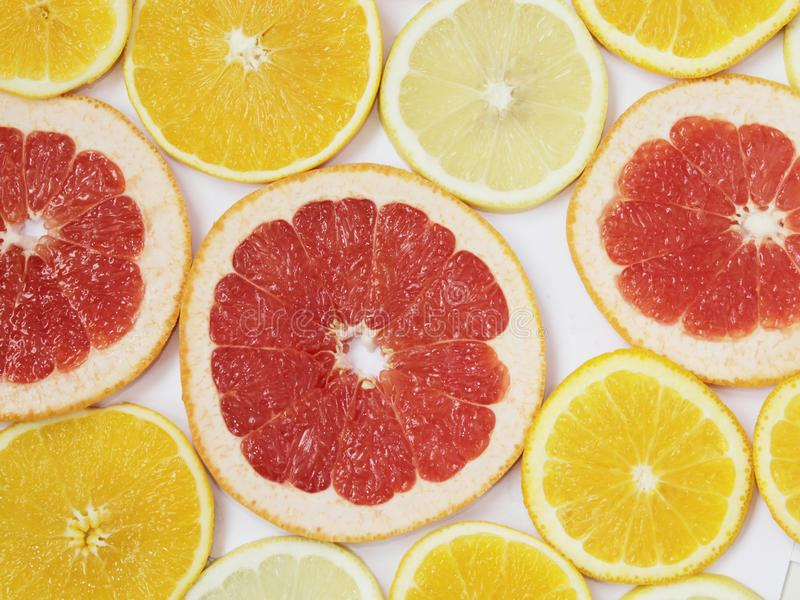 Citrus pattern of orange and grapefruit slices. Colored citrus pattern royalty free stock image