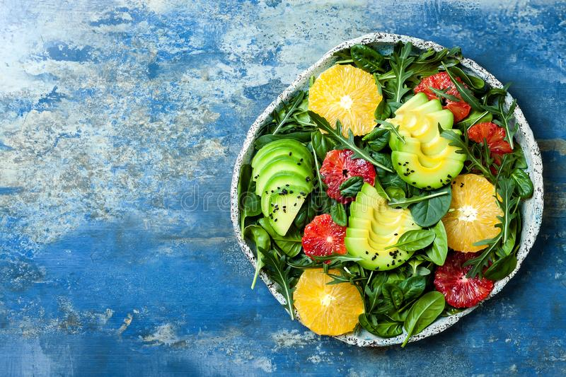 Citrus salad with mixed greens and blood orange. Vegan, vegetarian, clean eating, dieting, food concept. royalty free stock photo