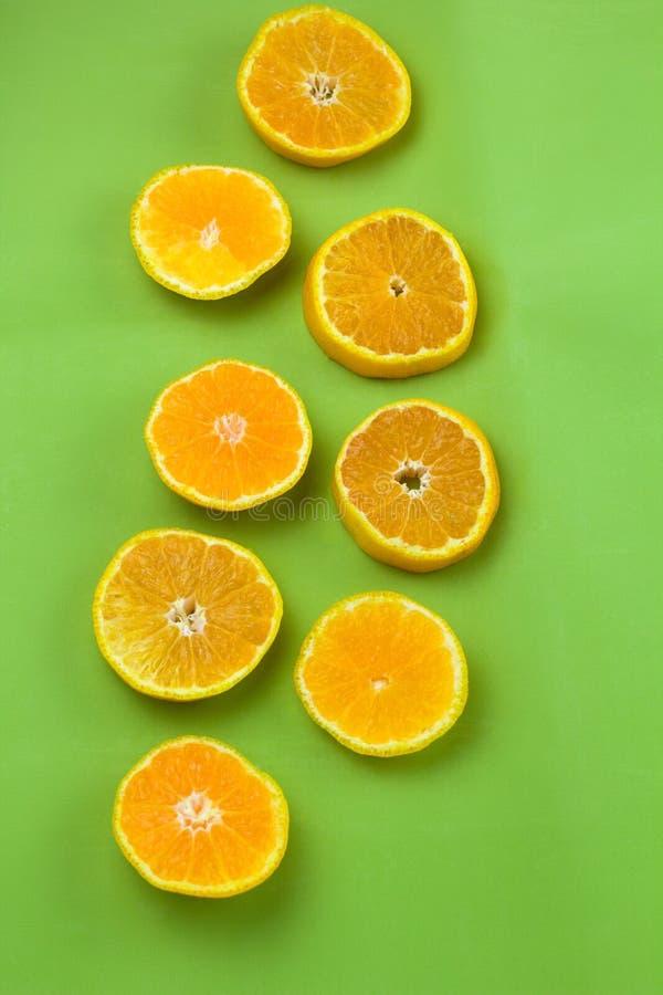 Citrus slices flat lay green backgroun. Top view citrus slices flat lay green backgroun royalty free stock photo