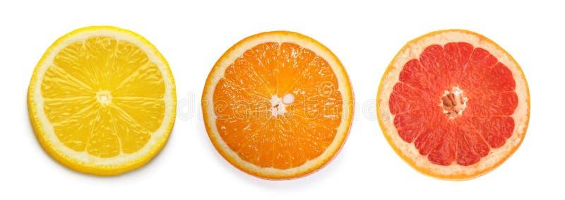 Citrus slices, orange, lemon, grapefruit, isolated on white background.  stock photos