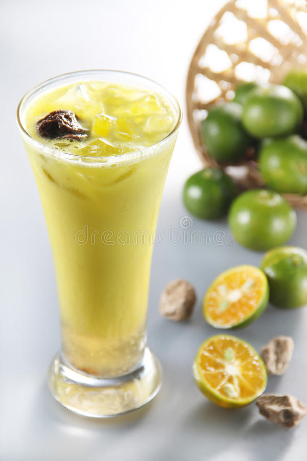 Citrus sour plum juice. With some citrus in background royalty free stock photos