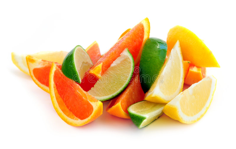 Citrus wedges. Wedges of assorted citrus fruits isolated on white background stock photography