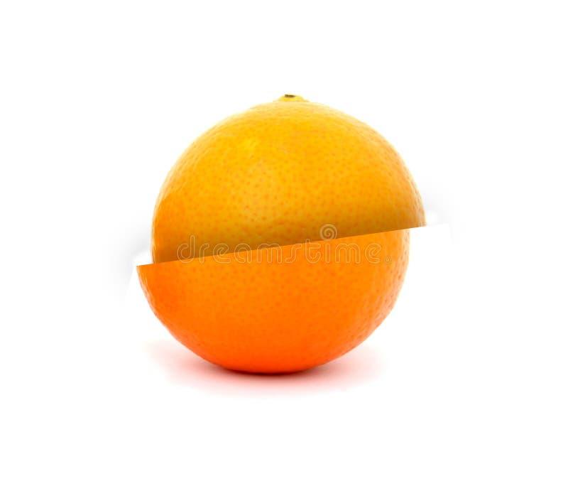 Citrusfrukt som är bruten in i två arkivfoto