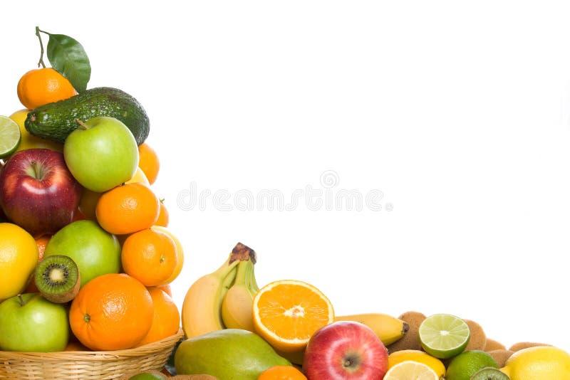 Citrusvrucht en tropisch fruit op witte achtergrond stock foto's