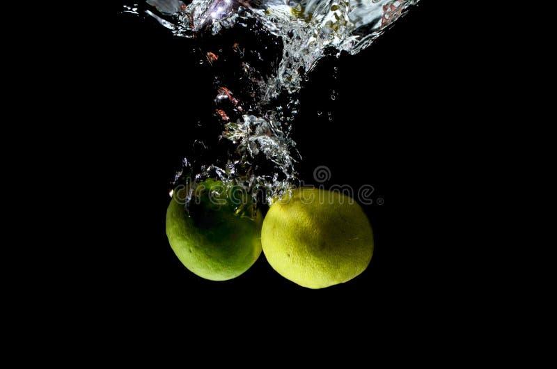 Citrusvruchten het bespatten royalty-vrije stock afbeeldingen