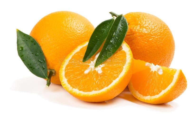 Citrusvruchten - sinaasappelen met plakken royalty-vrije stock foto's
