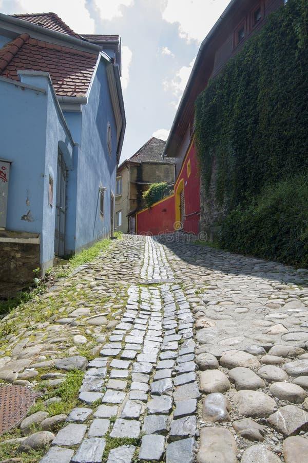 Città medioevale del sighisoara Mattone, pavimentazione immagine stock