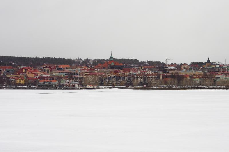 The city of Östersund in Sweden-02.03.2019. The city of Östersund in Jämtland,Sweden on a cold and snowy day by the frozen lake Storsjön stock photo