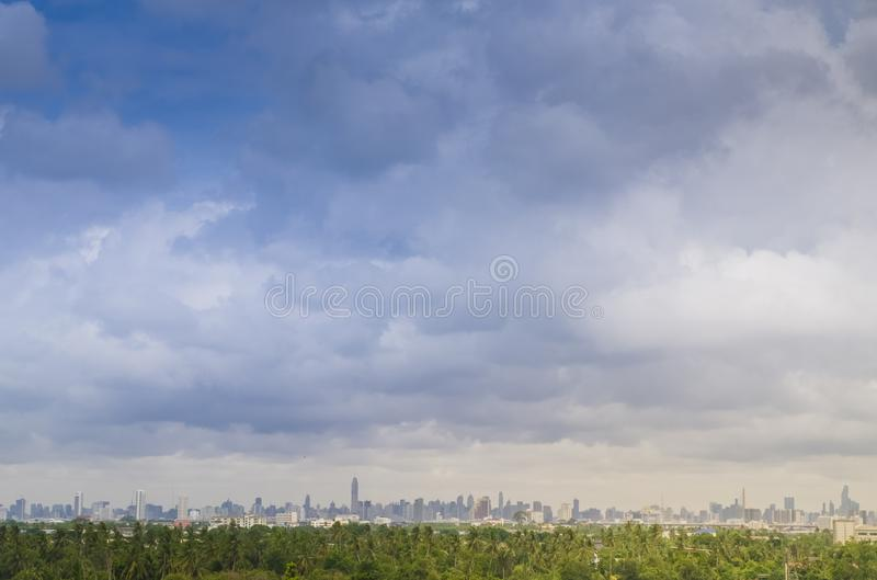 Tree nature area over City. Architectural modern buildings in panoramic view on background. City. Architectural modern buildings in panoramic view on background stock images
