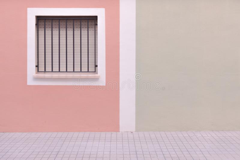 City background. Window on colorful wall and pavement royalty free stock photo