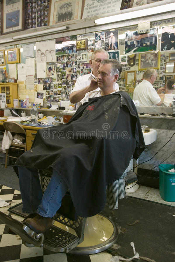 City Barber Shop. Floyd cutting hair at Floyd's City Barber Shop in Mount Airy, North Carolina, the town featured in �Mayberry RFD� and home of Andy royalty free stock photo