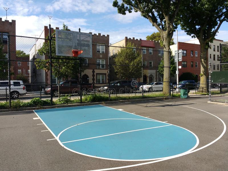 City Basketball Court, Urban Lifestyle, Astoria, Queens, NYC, USA. Basketball court in Hoyt Playground in Astoria, Queens, New York City. This photo was taken on royalty free stock image