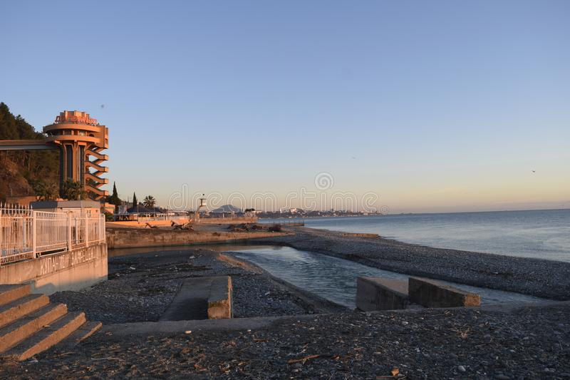 The city beach at the mouth of the river Dagomys stock images