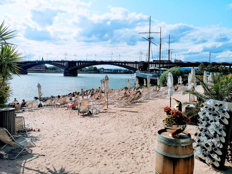 City beach (Rheinstrand) in Mainz-Kastel with theodor-heuss bridge in the background stock photo