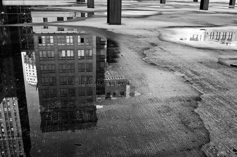 The City Below. The morning after a rainfall reveals reflections of the beautiful Detroit architecture royalty free stock photography