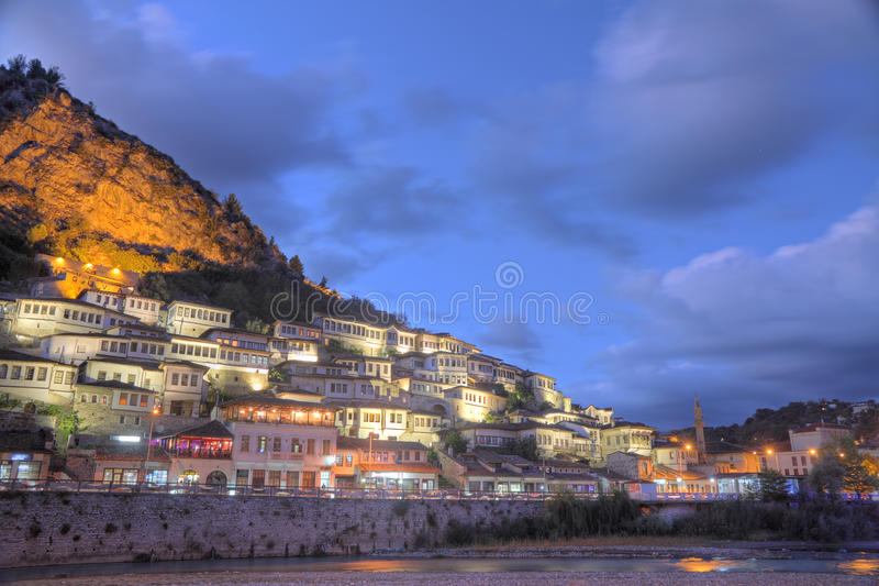 City of Berat in Albania at night. Historic city of Berat in Albania at night with all lights flashing, white houses gathering on a hill. It's also called city royalty free stock photos