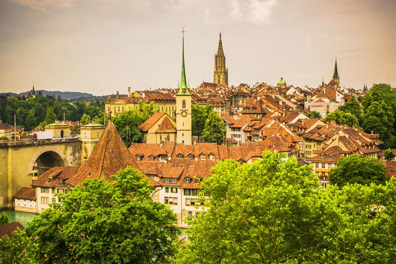 City Berne in Switzerland. Beautiful old architecture. Roof of houses with tiles. Old church and cathedral. Traveling in Europe. Capital of Switzerland stock photography