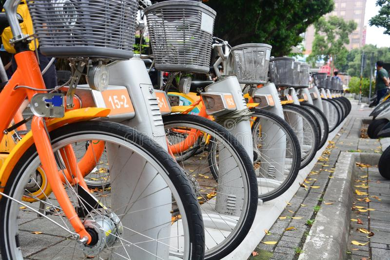 City bike, a row of public bicycles for rent parking on footpath in Taipei. Taiwan royalty free stock images
