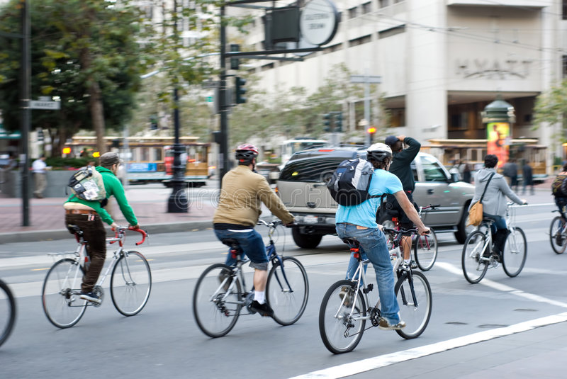 City bikers in San Francisco. Environmentally conscious bikers in traffic in San Francisco, California. Motion blur on the subjects - faces unrecognizable stock photo