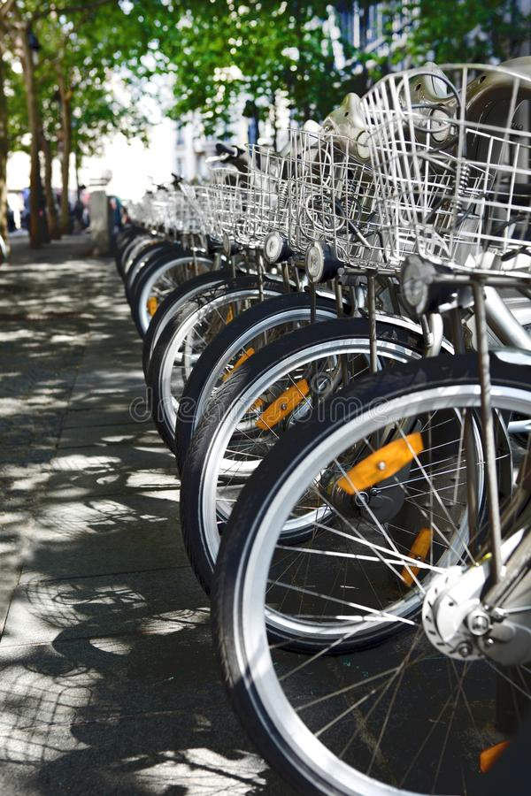 City bikes for rent parked in a row - alternative urban transportation means royalty free stock photo