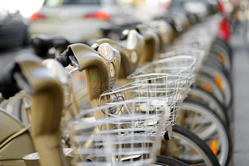 City bikes for rent. Row of city bikes for rent in Paris, France royalty free stock images