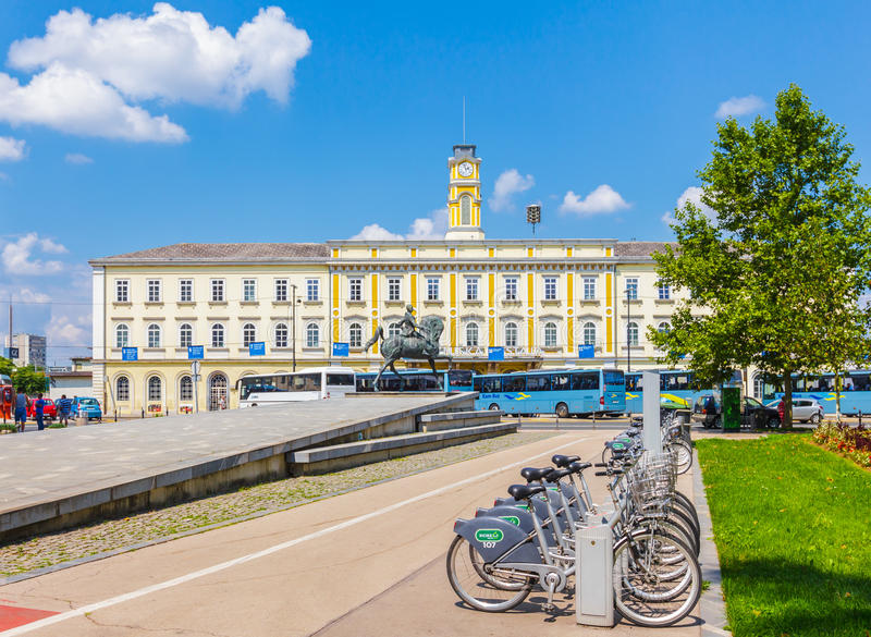 City bikes station in front of railway station, City of Ljubljana stock photography