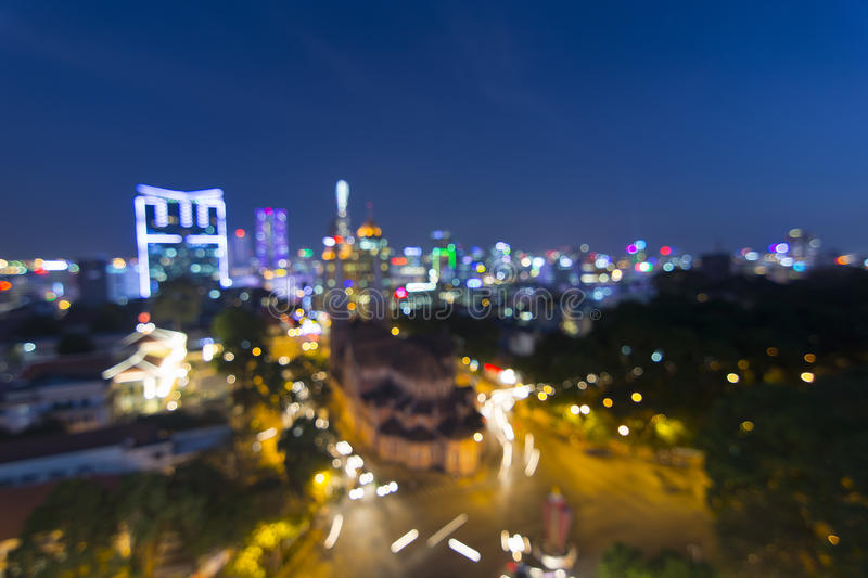 City blurring lights abstract circular bokeh on blue background royalty free stock photography