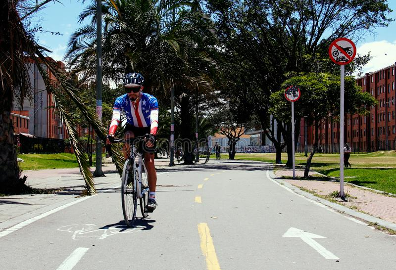 Man transiting on the cicloruta, largest in Latin America. In the city of Bogota, Colombia, is one of the largest bike paths in the world, which is mobilized stock photos