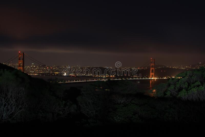 City bridge over river at night royalty free stock photography
