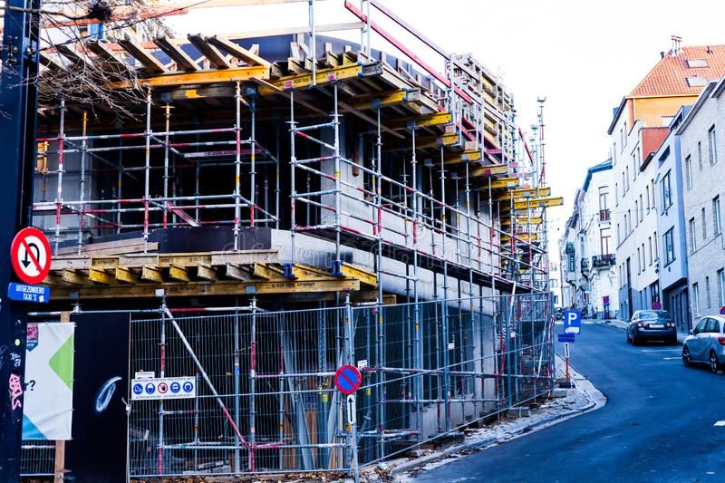 City of Brussels, Belgium, November 2018 Iron Beams and Steel Bar Scaffolding on the Building Exterior. Unfinished Two stock images