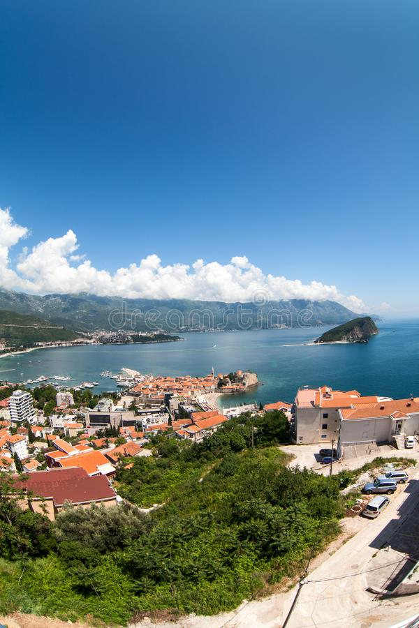 The city of Budva with the old town with fortified walls and red roofs. View from above, wide angle. Adriatic sea, Montenegro royalty free stock photos