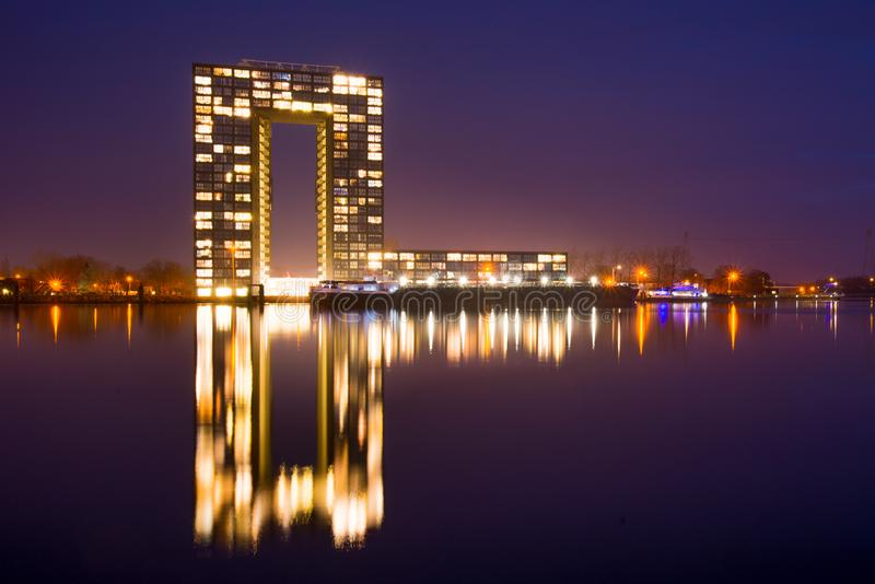 City Building Near Body of Water during Nighttime royalty free stock photography