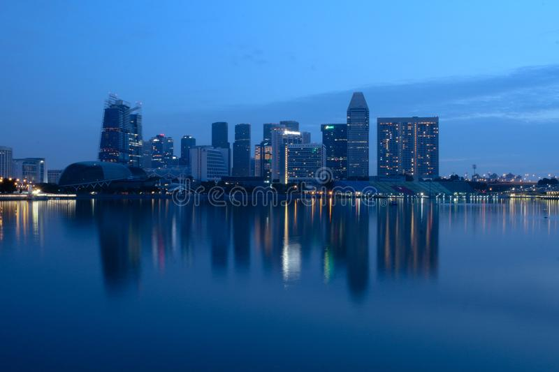 City Buildings Beside Body Of Water During Night Time royalty free stock photos