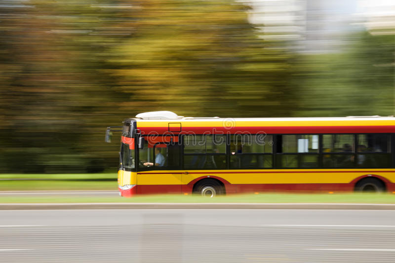 City bus in motion blur. City bus on a street in intentional panning motion blur royalty free stock photos
