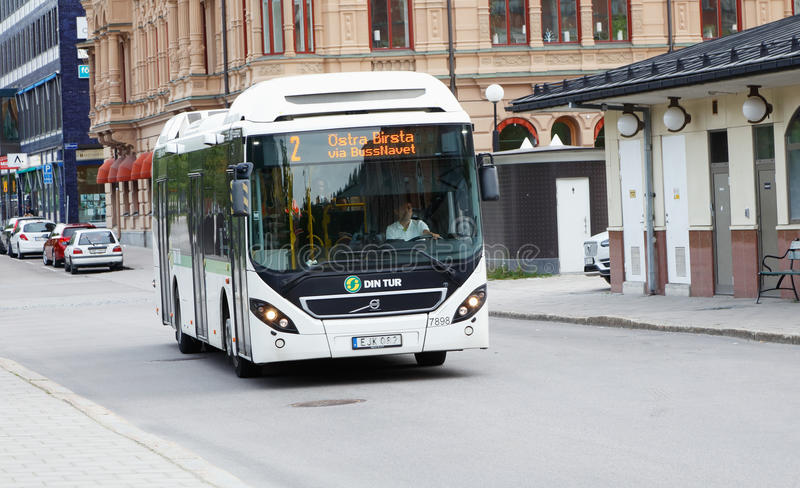 City bus in Sundsvall. Sundsvall, Sweden - May 30, 2016: One white public transport city bus in downtown Sundsval in trafic on line number 2.l stock image