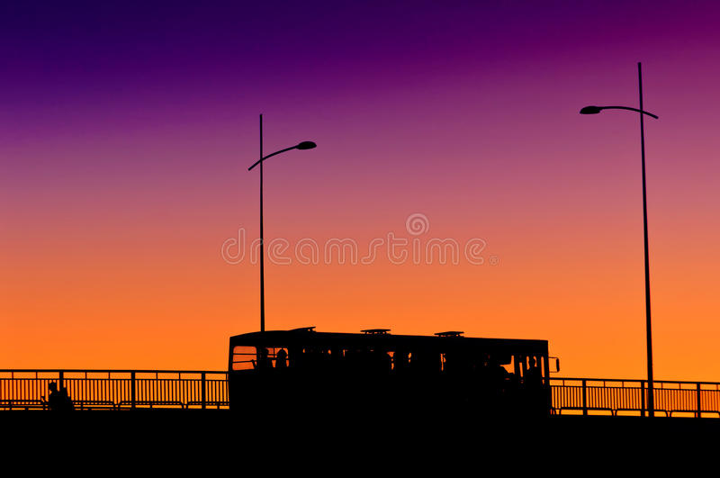 City bus in sunset stock image