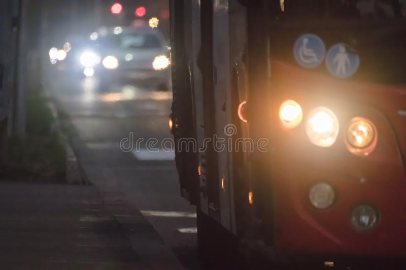 City bus with traffic at night stock photos