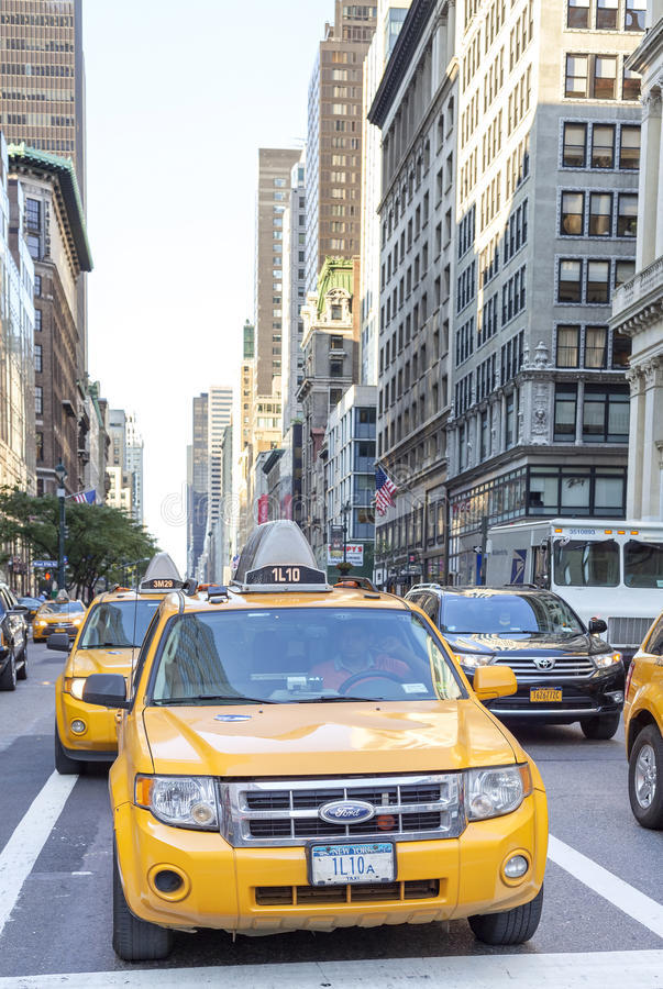 City cabs waiting in a traffic on street of Manhattan. stock photo