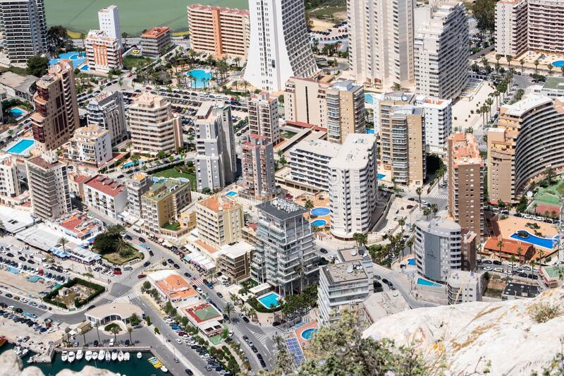 City of Calpe and its buildings on the east coast of Spain in a spring hot day stock image