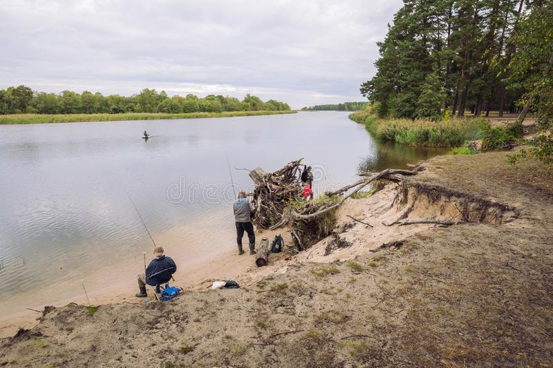 City Carnikava, Latvian Republic. Fisherman catching fish in the river, nature, silence and water waves. Sep 04. 2019 royalty free stock photography