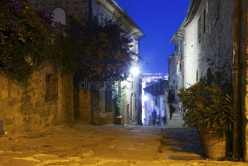 Ancient streets at night in the city `Castiglione della Pescaia`. royalty free stock photo