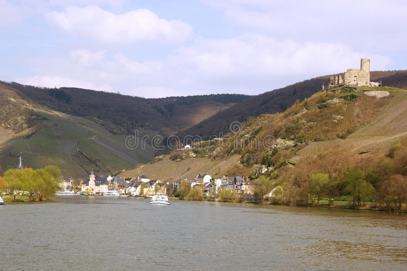 City and the castle of Bernkastel-Kues on the river Mosel in Germany. View of Bernkastel-Kues on Mosel river, Germany on a sunny day stock photo