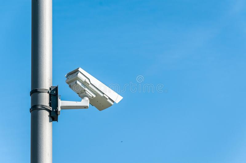 City cctv security surveillance camera system attached on the traffic light pole with clear blue sky background royalty free stock image