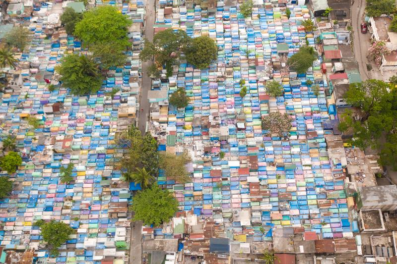 City cemetery in Manila, view from above. Old cemetery with residential buildings. City cemetery in Manila, view from above. Many stone coffins and crypts. Old royalty free stock photos