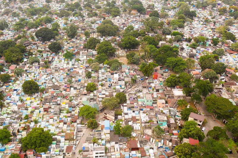 City cemetery in Manila, view from above. Old cemetery with residential buildings. City cemetery in Manila, view from above. Many stone coffins and crypts. Old royalty free stock image