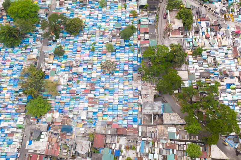 City cemetery in Manila, view from above. Old cemetery with residential buildings. City cemetery in Manila, view from above. Many stone coffins and crypts. Old royalty free stock photography